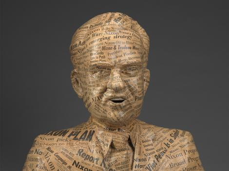 Sculpture of Richard Nixon created from newspaper strips