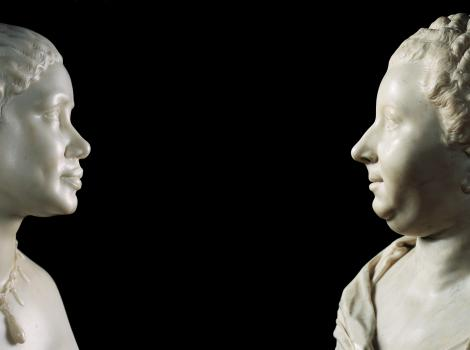 Marble sculpture of an African American woman and an older white woman facing each other