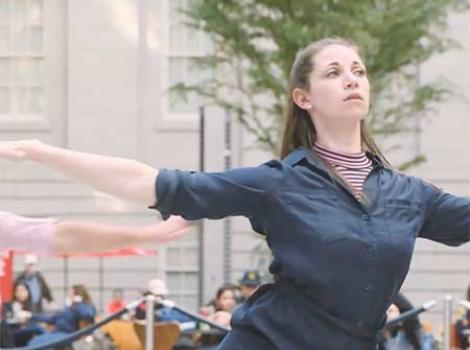 Woman performing in the courtyard