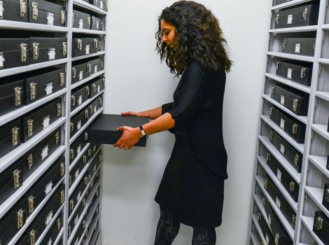 Researcher pulling files