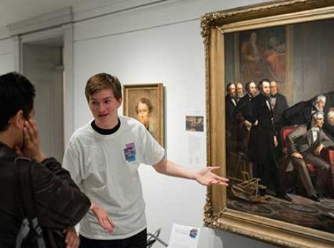 Teen gesturing at a painting