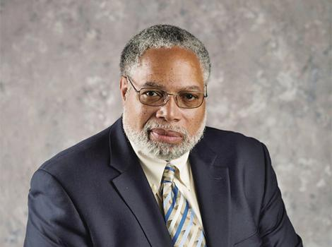 African American man with gray hair and beard