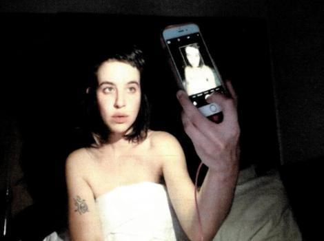 Woman taking a selfie in a darkened room