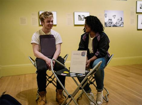 two teens talking in the gallery