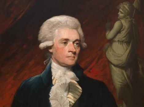 18th century man  in a powdered wig and dark suit