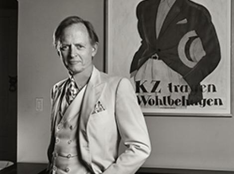 Black and white portrait of a man in a white suit