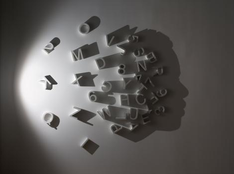 Silhouetted face comprised of letters and numbers