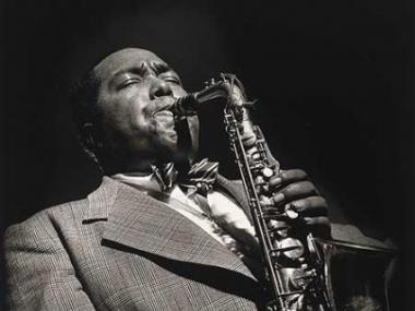 Black and white photo of musician plating the saxophone