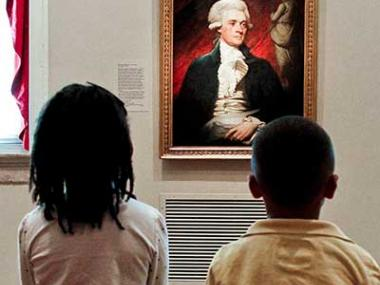 Two children looking at Thomas Jefferson portrait