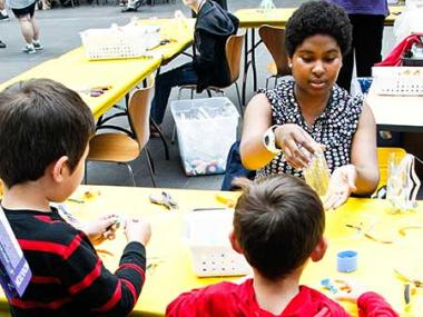 A Smithsonian volunteer doing arts activities with kids