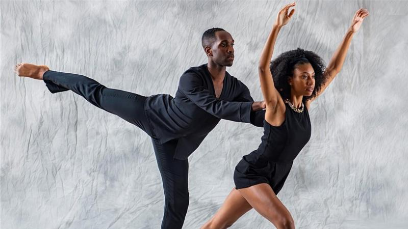 Two African American ballet dancers dressed in black