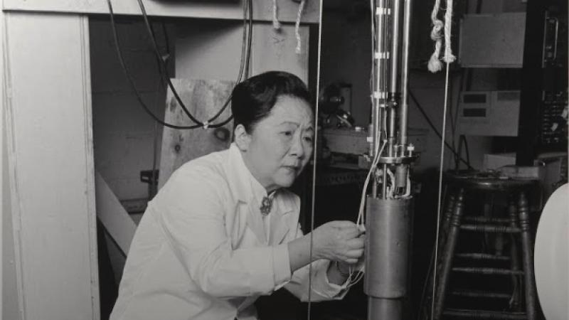 woman in a lab coat working on a nuclear device