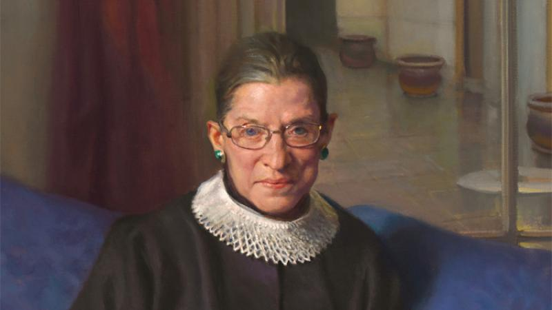 Female justice in her black robes with a white lace collar