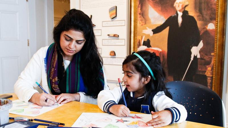 little girl and mother working on an art project