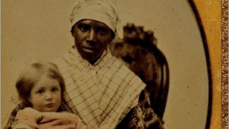 book jacket of an enslaved woman holding a white child on her lap