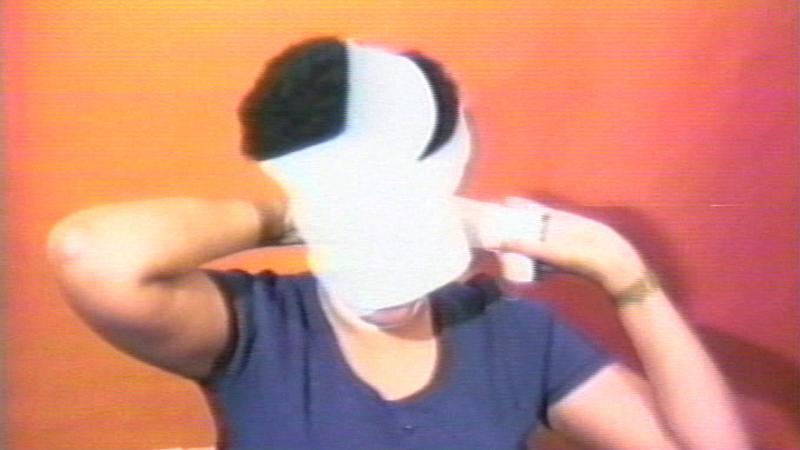Woman wrapping her head in white gauze