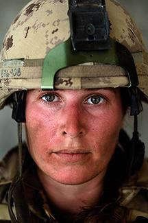 Close-up photographic portrait of a young female soldier (medic)
