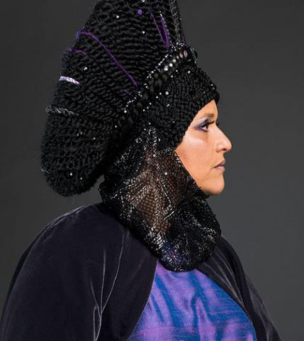 Wanda Raimundi-Ortiz in purple headress and gown