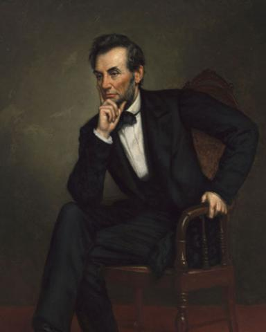 Portrait of Abraham Lincoln sitting and with hand on chin