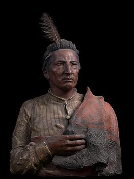 Sclptural portrait of a Native American man wearing a stripes shirt, a blanket over his shoulder and a single feather in a headband
