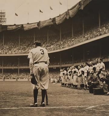Babe Ruth standing in Yankee Stadium after his retirement wihile the crowd cheers