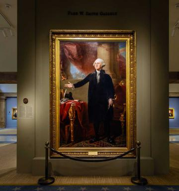 entrance to the exhibition featuring a large painting of Washington