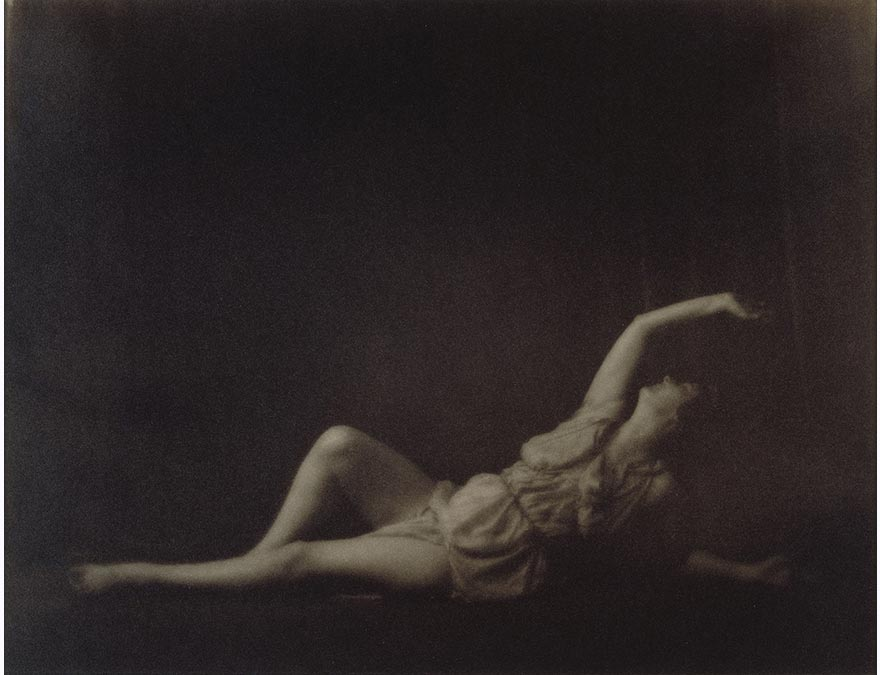woman dancer reclining on the floor