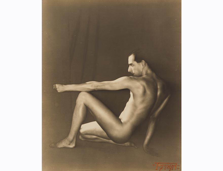 Nude man in profile seated on the floor with his arm outstretched