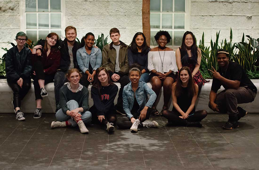 Group photo of the Teen Museum council - a young diverse group of 13 students