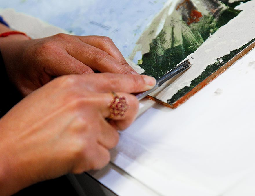 Conservator working on a piece of art