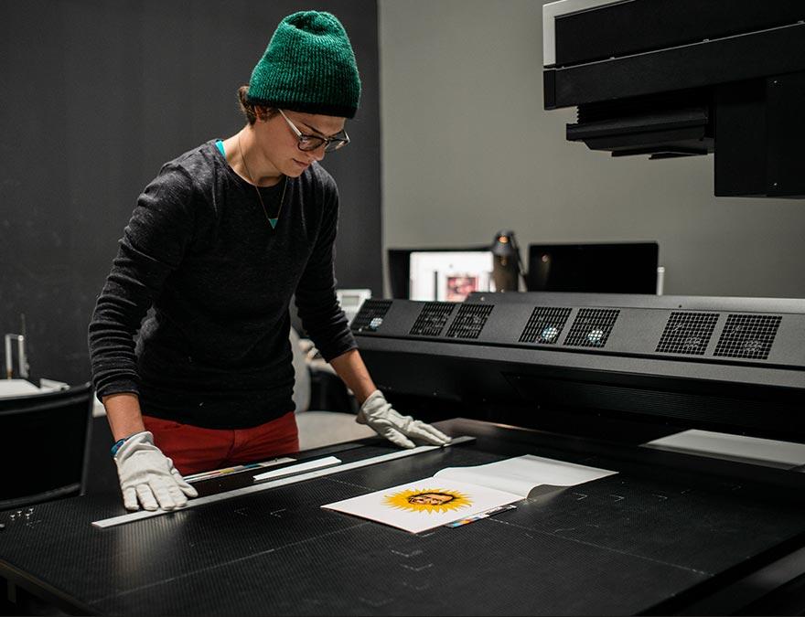 Photographer scanning a work of art