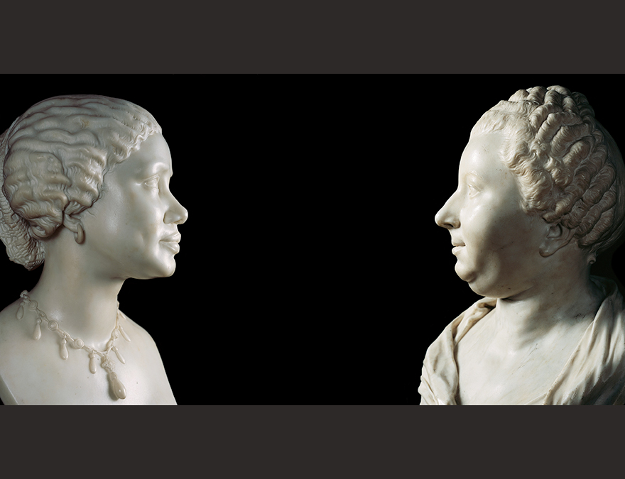White marble busts of a young African American woman and an older white woman