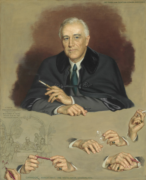 Seated man in a dark suit with his hands painted in several different poses