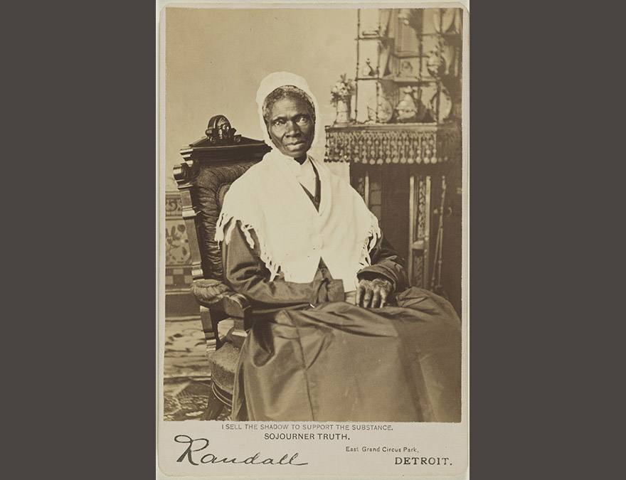 Photo of an loder African American woman in a long dress