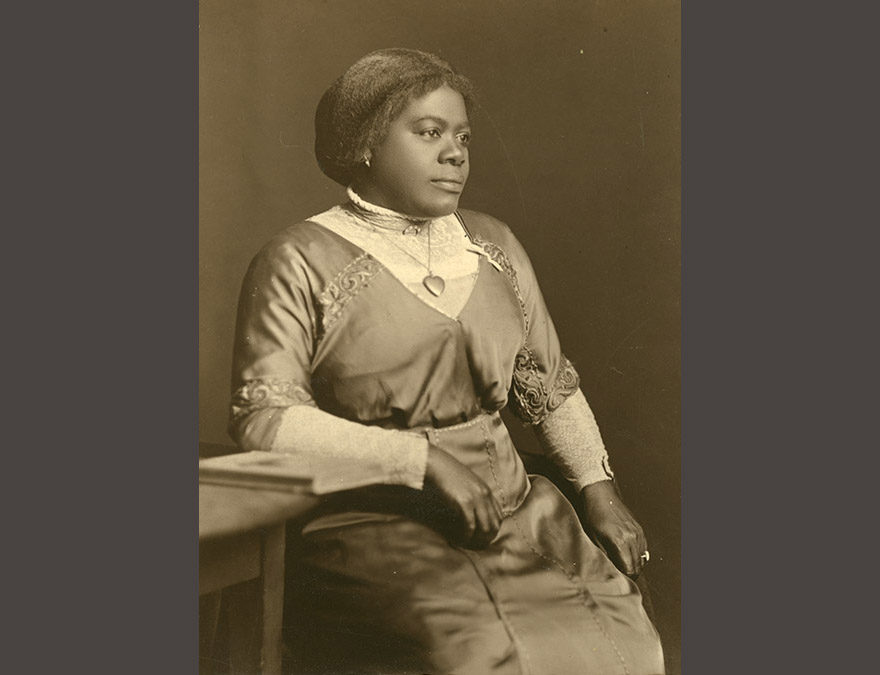 Photo of a seated African American woman in a long dress