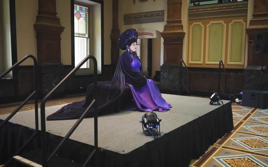 woman in a purple queen-like costume