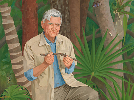 white haired man in the jungle
